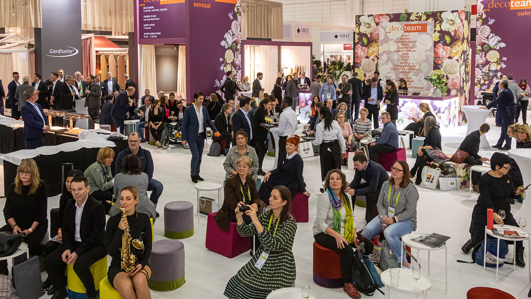 Heimtextil visitors  are sitting together